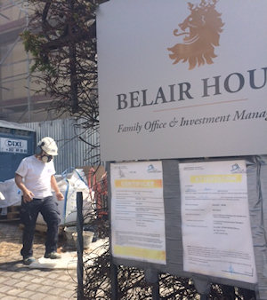 Belair House Luxembourg workman with hard hat and company sign