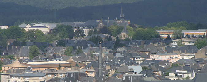 This panoramic view of Luxembourg rooftops nestled amongst hills gives one answer to the Why invest in Luxembourg? question, but financial practicalities are no less important.