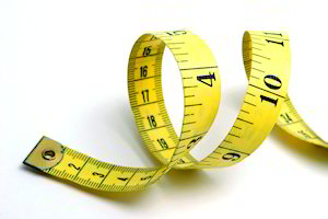 Yellow measuring tape to represent global measurement standards