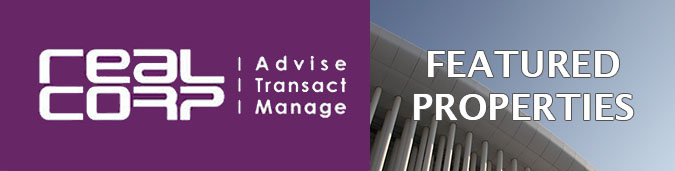 Newsletter header image showing on the left in white on a purple background the RealCorp logo including the words Advise, Transact, Manage, and on the right an artistic photo of the white columns of the Luxembourg Philharmonic building against a blue sky, behind the words Featured Properties in white. This newsletter includes Properties in Ville Haute - CBD and other Luxembourg localities.